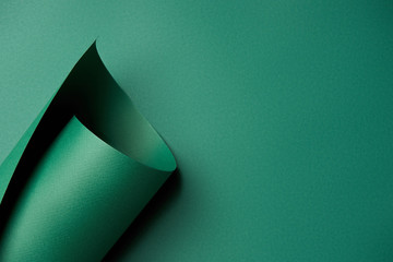 close-up view of beautiful bright abstract green paper background