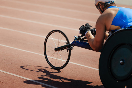 men wheelchair racer on track stadium competition disabled