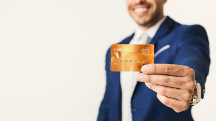 Golden credit card in businessman hand