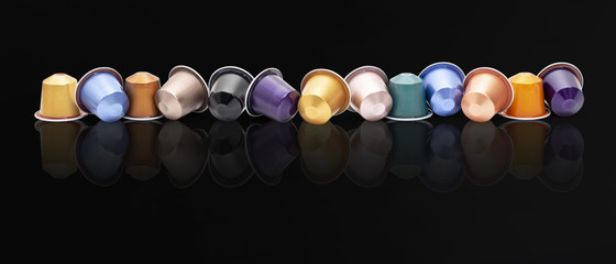 colored espresso coffee capsules on black background