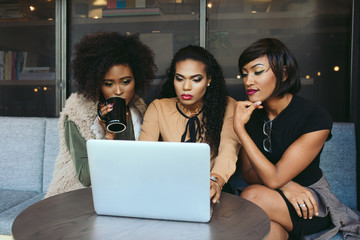 Young businesswomen using a laptop while sitting in office