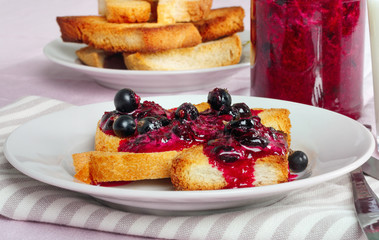 Delicious toasts bread with homemade currant jam with fork and knife