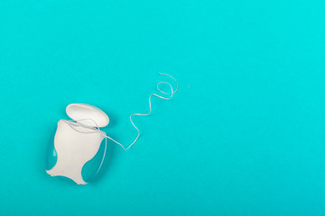 dental floss box on blue background top view