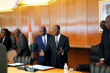 Ivory Coast President Alassane Ouattara gestures during the first cabinet meeting at the presidential palace in Abidjan