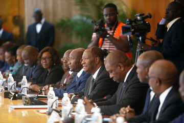 Ivory Coast President Alassane Ouattara and the new government members attend their first cabinet meeting at the presidential palace in Abidjan