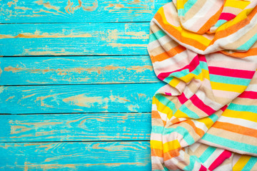 Summer beach towel on colored background