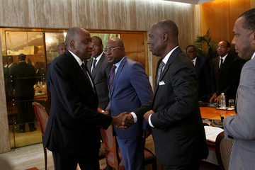 Ivory Coast Prime Minister Amadou Gon Coulibaly shakes hands with the members of the new government during the first cabinet meeting at the presidential palace in Abidjan