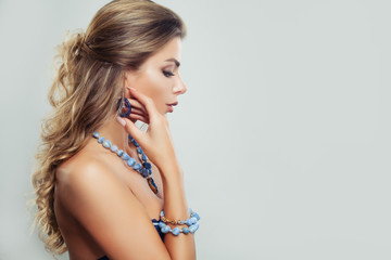 Perfect Young Woman with Wavy Brown Hair and Jewelry Necklace on Gray Background