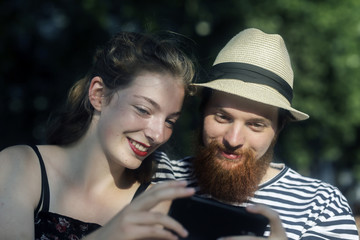 Smiling couple looking at a mobile phone