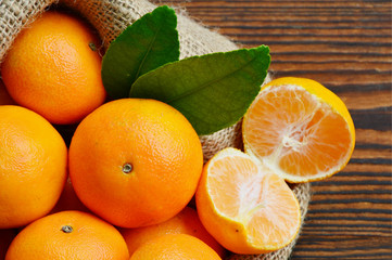 Nutritional Value of a Clementine. A lot of Clementines,orange or citrus in sack bag on wooden background