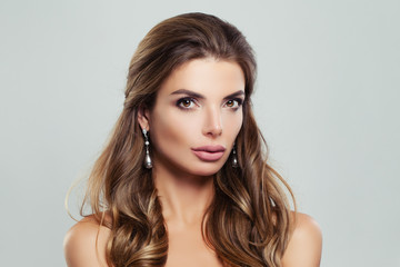 Perfect Woman with Wavy Brown Hair and Pearls Earrings, Fashion Beauty Portrait