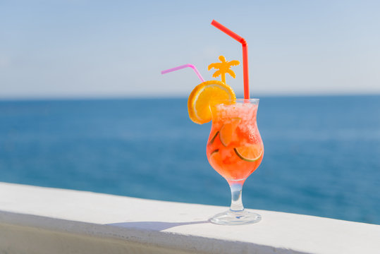 Cocktail on a wall by the sea
