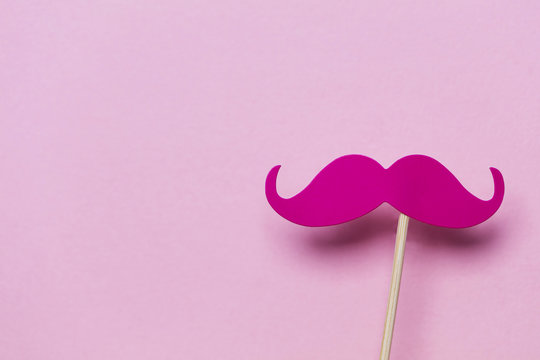 Pink moustache on a pink background. Modern masculinity concept