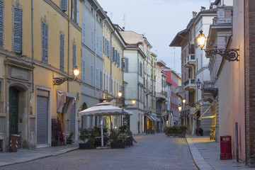 PARMA, ITALY - APRIL 18, 2018: The street of the old town at dusk.