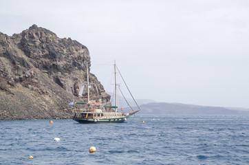 Wooden ship for trip near island Terasia and Santorini