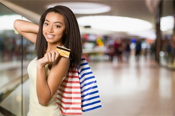 Young woman holding credit card and shoping