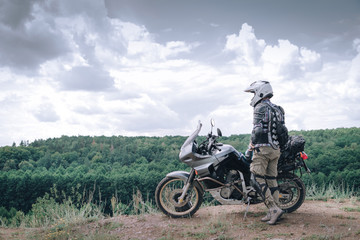 Adventure motorcycle, Motorcyclist gear, A motorbike driver looks, concept of active lifestyle, enduro travel road trip