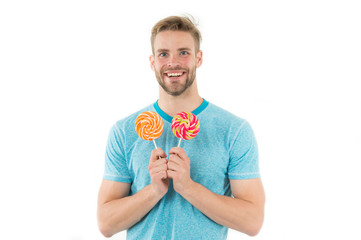 lollipop. happy man with lollipop isolated on white. lollipop in hand of smiling guy. sugar candy in lollipop shop. Sweet look.