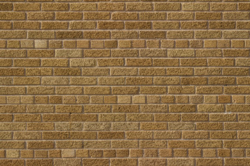 Vintage golden brown color brick wall background in Scottish bond pattern