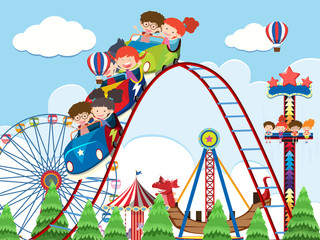 Children and rides at amusement park