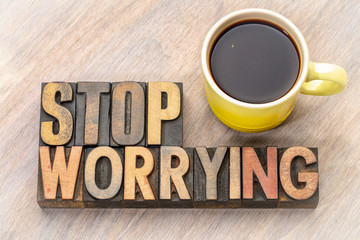 stop worrying word abstract in wood type