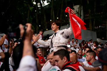 Peruvian bullfighter Andres Roca Rey is brought out of the bullring on people's shoulders following his performance in a bullfight on the sixth day of the San Fermin festival in Pamplona