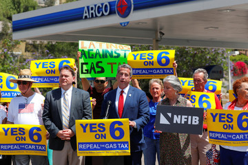 California director of the National Federation of Independent Business John Kabateck speaks on California's Proposition 6, a growing movement to repeal a state gas tax, during an announcement from an Arco gas station in San Diego