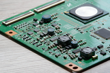 Close up photo of circuit board on wooden background