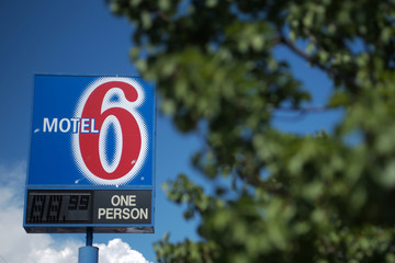 A sign marks a Motel 6 property in Espanola