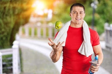 Athletic man with towel on neck