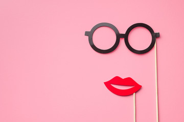 Fake paper glasses and lips.