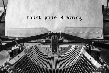 Count your Blessing, the text is typed in a vintage typewriter. Old paper, close-up.