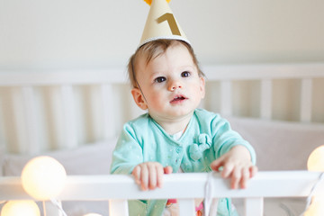 Portrait Of Cute Baby Girl Wearing Birthday Hat One Year Old Celebration