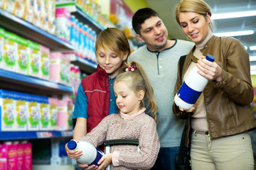 Family of customers with children purchasing milk