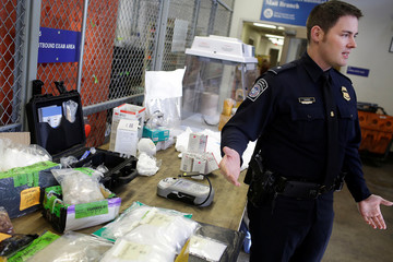 U.S. Customs and Border Protection officer Davies talks about plastic bags of Fentanyl being discovered in the mail at the International Mail Facility at O'Hare International Airport in Chicago