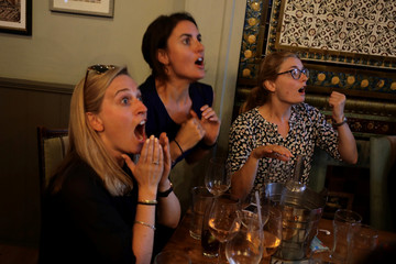 Women in a pub in Fulham react to play during the World Cup Semi-final between England and Croatia in London