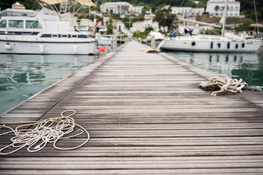 Wooden pier with mooring rope