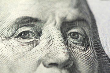 close-up view of banjamin franklin face on dollars note