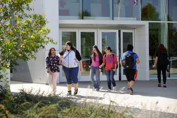 People walk along the campus of DeVry University in Chicago