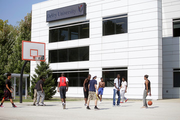 A group of men play basketball on the campus of DeVry University in Chicago