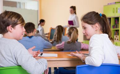 Children discussing during lesson