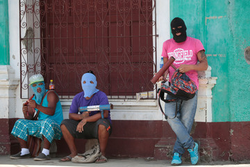 Demonstrators stand next to a barricade in the indigenous community of Monimbo in Masaya