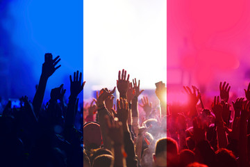 football fans supporting France - crowd in stadium with raised hands against french flag - fifa world cup