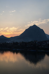 Reflections of a mountain in the Pak river in Laos in Nong Kiaw