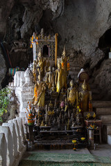 Buddha statues in the lower Pak Ou Cave besides the Mekong river 25km upstream of Luang Prabang
