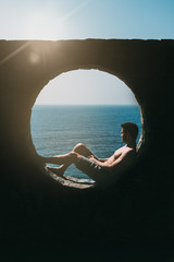 Man sitting contemplating the sea view