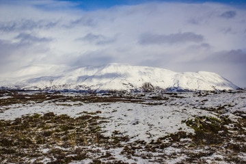 Clouds Passing over a Snowy Mountain Peak with Tundra in the Foreground in the Golden Circle of Iceland