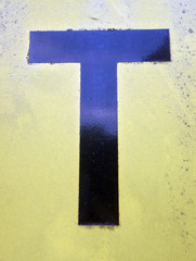 Written Wording in Distressed State Typography Found Letter T