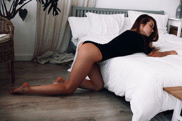 The girl on the white bed.Girl in underwear.Sexy girl posing on the bed.Sexy figure