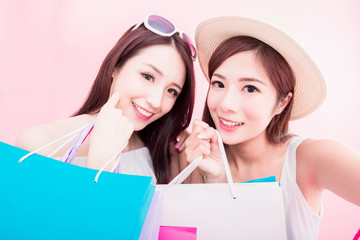 two shopping woman selfie happily